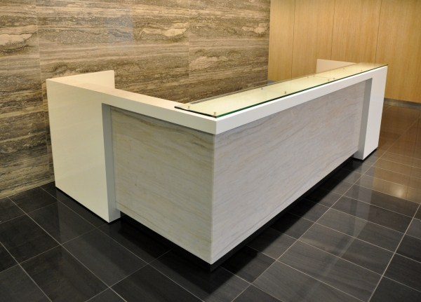 This Custom Reception Desk Designed By The Switzer Group Features A 1 2 Clear Gl Transaction Counter On D Polished Stainless Steel Stand Offs