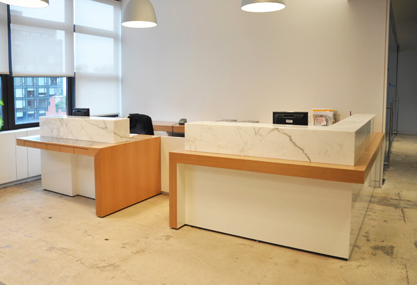 This two person reception desk features Calacatta Carrara marble